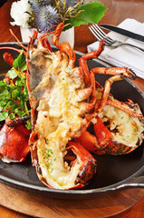 Delicious roasted lobster dinner with  fresh herbs