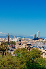 Aerial Panorama view of Barcelona city skyline over Passeig de Colom or Columbus avenue and Port Vell marina