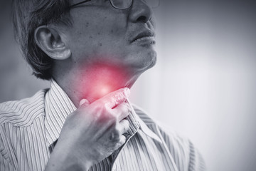 Asian elder old man Sore throat irritation and have a phlegm hand touching neck.