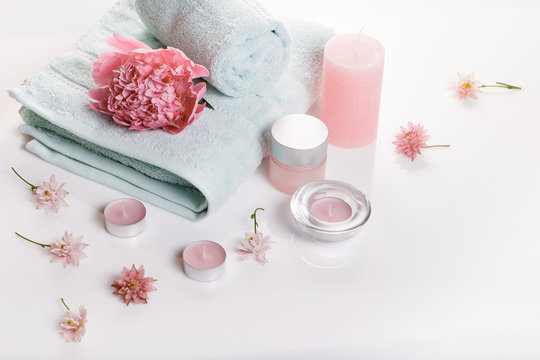 Spa concept in Valentine's Day, Birthday Day, pink peony, candles, blue towels, flowers. Spring or summer background