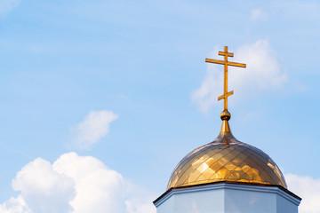 Orthodox cross on dome of church