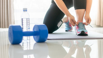 Lace up for the workout at fitness gym