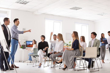 Business trainers giving lecture in office