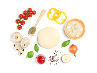 Dough and ingredients for pizza on white background, top view