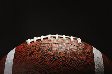 New American football ball on dark background Wall mural