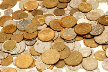 The texture of Russian coins, a large number of coins, Russian rubles and kopecks.