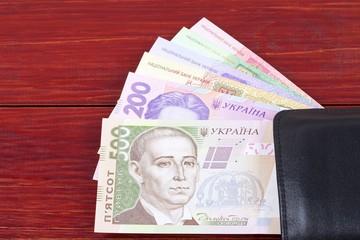 Ukrainian money in the black wallet