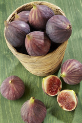 pouring out figs from wicker basket