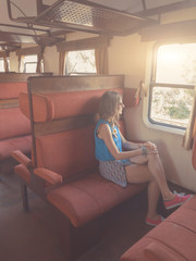 Girl travelling with a retro / vintage train.