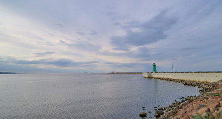 Lighthouse in Nowy Port in Gdansk, Poland. Quay - entry to the p