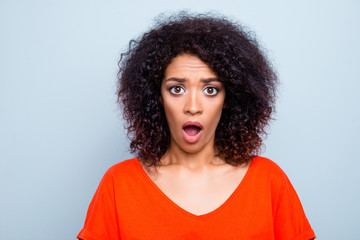 Head shot portrait of shocked astonished woman with wide open mouth eyes having problem looking at camera isolated on grey background