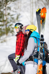 Image of sports men and women with mountain skis walking on snow hill