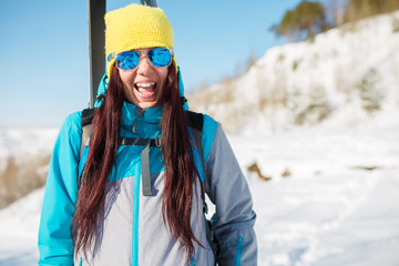 Picture of sports girl with skis and sticks in winter