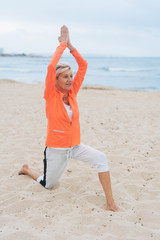 Fit healthy woman working out on a sandy beach