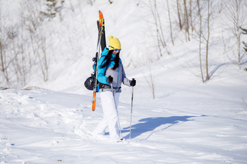 Photo of sporty woman with skis and sticks in winter