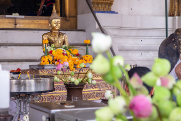 Buddha with incense, candles, flowers and took them to worship