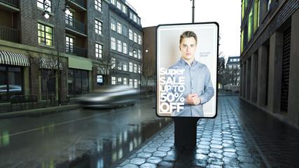 Fashion advertisement billboard on city street at evening