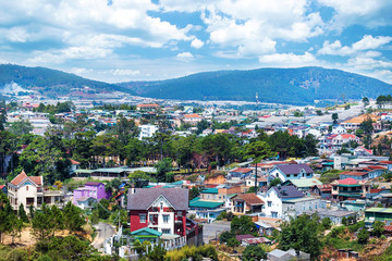 Beautiful houses with in the Da Lat city (Dalat) on the blue sky background in Vietnam. Da Lat and the surrounding area is a popular tourist destination of Asia.