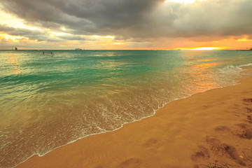 Twilight at Waikiki beach in Oahu. Waikiki beach is a beautiful place to enjoy the sunset over the ocean. Waikiki in South Shore, is the neighborhood of Honolulu and the most popular beach of Hawai.