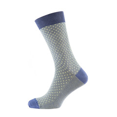 one colored sock is standing on a shape, the shape is not visible, on a white background is isolated