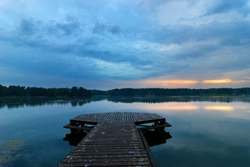 View from wooden pier on a lake during stormy weather