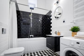 White bathroom with bathtub