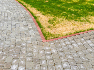 Paving stone on the street pattern brick surface. Grey and red abstract background