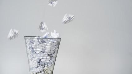 Throwing crumpled paper in basket