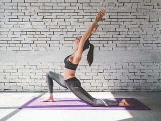 Portrait of attractive woman doing exercises. Brunette with fit body on yoga mat. Healthy lifestyle and sports concept. Series of exercise poses. Fototapete