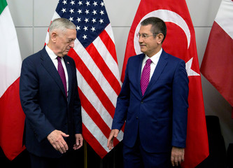 U.S. Secretary of Defence Mattis poses with Turkish Defence Minister Canikli during a NATO defence ministers meeting in Brussels