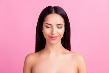 Close up portrait of perfect ideal pretty charming pure flawless  woman with close eyes and elegant nude make up, isolated on pink background, copyspace