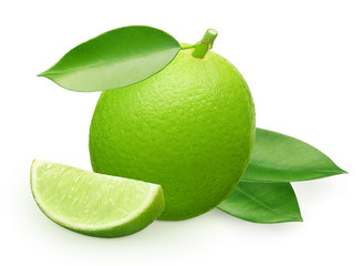 Lime fruit with slice and green leaves isolated on white