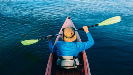 Man Kayaking on a pristine lake, top view