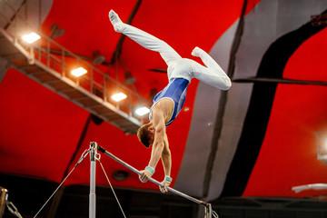 Door stickers Gymnastics men gymnast exercises on high bar in artistic gymnastics