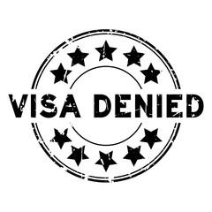Grunge black visa denied with star icon round rubber seal stamp on white background