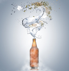 Cold beer with pieces of ice and drops by the bottle and splashes of water, lupus, malt on gray background