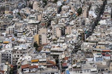 Greece, Athens: Skyline with mass of houses, buildings, apartments, rooftops in the city center of Greek capital - concept urban development town planning structure living condition.
