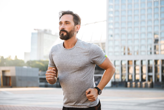 Handsome strong mature sportsman running
