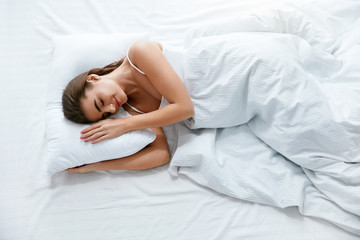 Healthy Sleep. Woman Sleeping On White Bedding