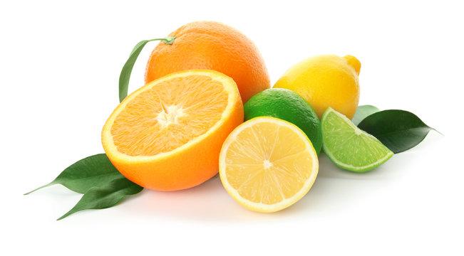 Tasty citrus fruits on white background