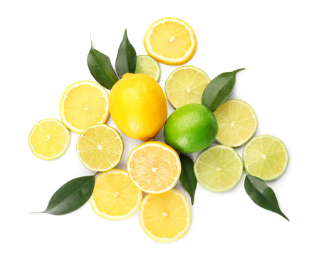 Composition with cut citrus fruits on white background