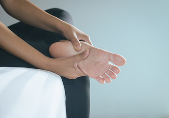Close up of woman having a foot sole pain,Female feeling exhausted and painful