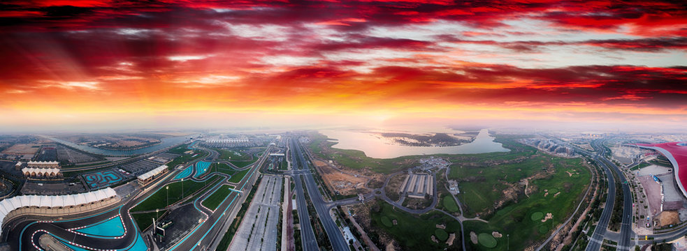 Yas Island, Abu Dhabi. Panoramic aerial view of main landmarks at dusk, United Arab Emirates