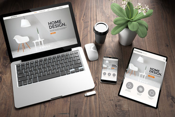 three devices on wooden desk top view interior design website