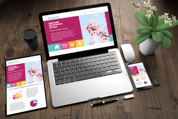 Wall Mural - tablet, laptop and mobile phone over wooden desktop showing responsive website