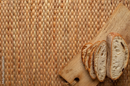 cut slices bread showing air texture of flour on wood block with weave background and copy