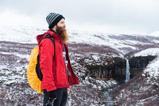 Man posing in snowy landscape