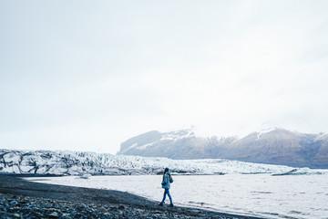 Woman walking in picturesque snowy landscape