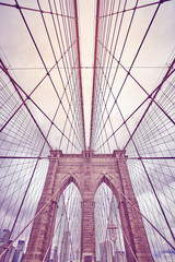 Looking up at the Brooklyn Bridge, color toned picture, New York City, USA.