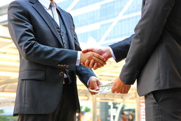 two business men change benafit hand to hand